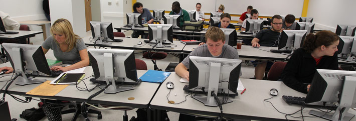 Students in a lab focus on getting homework done